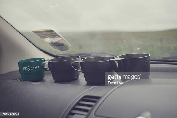 Cups of tea on a dashboard