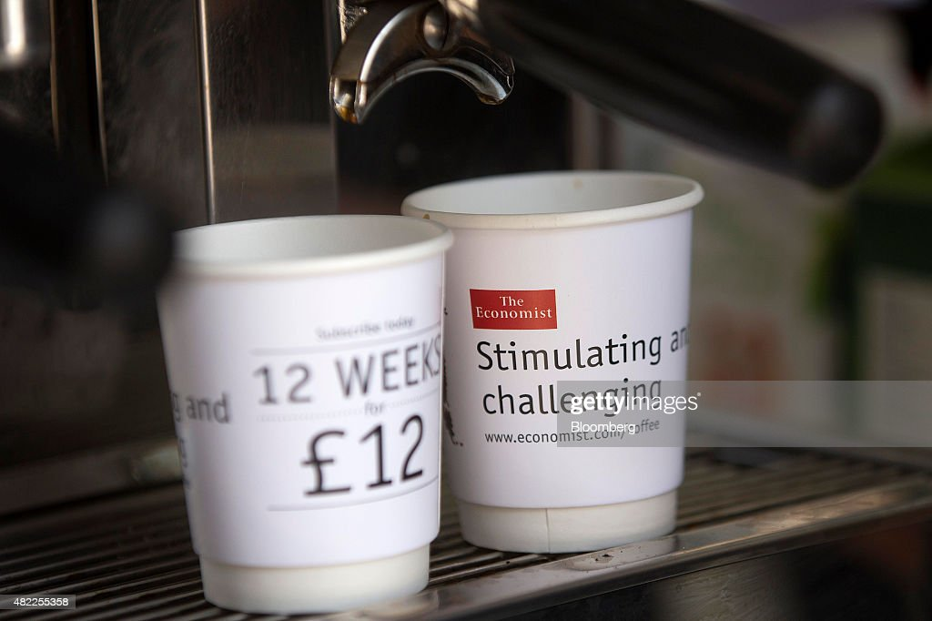 Cups sit on a coffee machine during a promotional subscription event for The Economist magazine offering free Kopi Luwak Civet coffee, in London, U.K., on Wednesday, July 29, 2015. Pearson Plc moved closer to an exit from business publishing as it announced plans to dispose of its stake in the 172-year-old Economist magazine, just days after the sale of the Financial Times newspaper. Photographer: Simon Dawson/Bloomberg via Getty Images