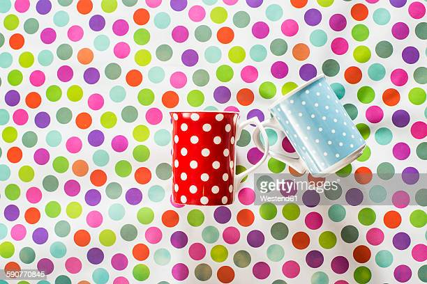 Cups with white points on colorful background