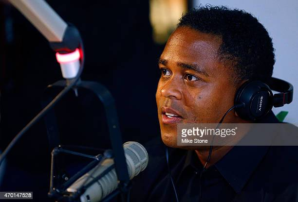 Curacao national football team coach Patrick Kluivert is interviewed by KTCK 1310 The Ticket radio station as he promotes the 2015 UEFA Champions...