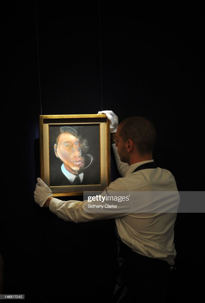 A curator adjusts 'Self Portrait' by Francis Bacon is put on display at Sotheby's on June 14, 2012 in London, England. This piece is part of the Impressionist & Modern and Contemporary Art sale at Sotheby's which will be held on June 19, 2012 and June 20, 2012.