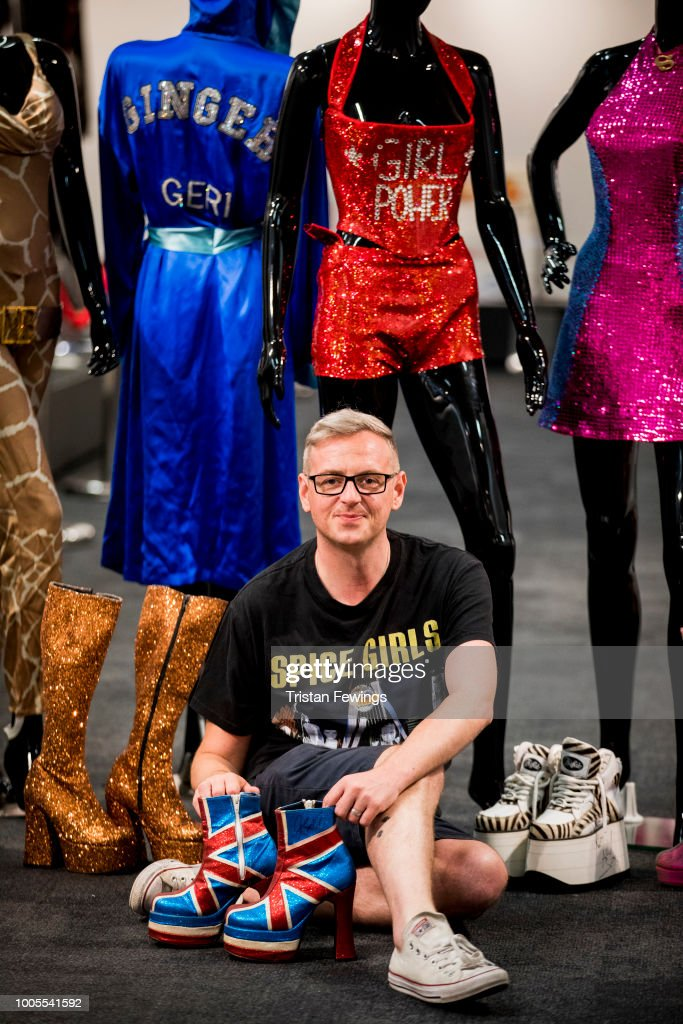 Curator Alan Smith Allison Poses With Spice Girls Costumes During