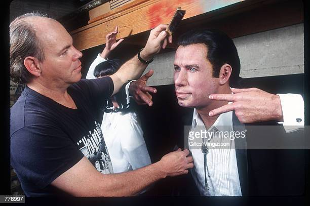 Curator and chief wax artist Ken Horn works on a replica of John Travolta from 'Pulp Fiction' January 1998 in Hollywood The Hollywood Wax Museum pays...