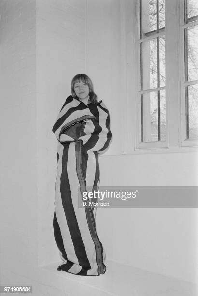 Curator and collector of native textiles Mary Hunt Kahlenberg covering herself with a Navajo blanket at the Los Angeles County Museum of Art...