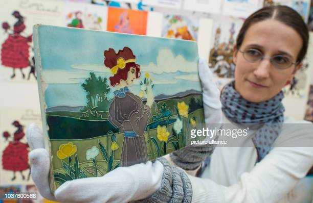 Curator and research assistant Elisabeth Hammann-Labitzke holds up a picture with Snowwhite in the Museum Viadrina inFrankfurt,Germany, 20 November...