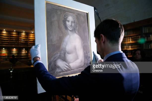 "Curator at the Conde Museum Mathieu Deldicque handles a charcoal drawing known as the ""Monna Vanna"", also dubbed ""The Nude Mona Lisa"" during a press..."