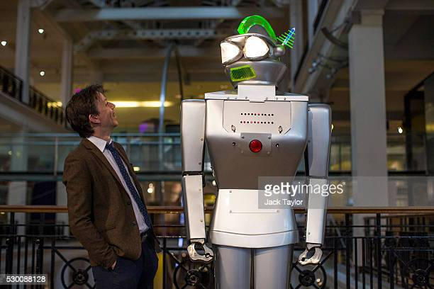 Curator Ben Russell poses with a 24 meter robot called Cygan built in 1957 on display during a press preview at the Science Museum on May 10 2016 in...