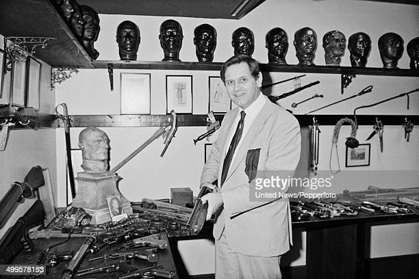 Curator Bill Waddell posed with various exhibits in the Black Museum or Crime Museum at New Scotland Yard headquarters of the Metropolitan Police in...