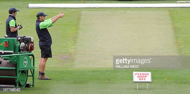 MCG curator Cameron Hodgkins gives the thumbs up as he prepares the pitch in preparation for the fourth Ashes cricket Test in Melbourne on December...