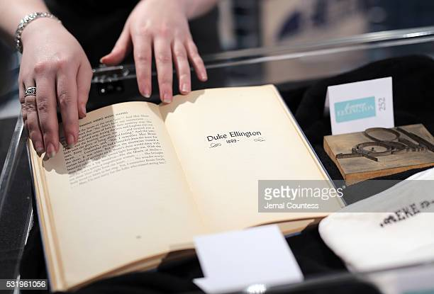 "Curator displays a copy of the book ""Famous Negro Music Makers"" written and signed by author Langston Hughes which is one of the items from..."