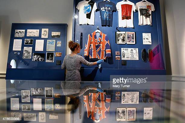 A curator dusts a cabinet containing one of Paul Weller's iconic jackets featured in 'The Jam About the Young Idea' at Somerset House on June 25th...