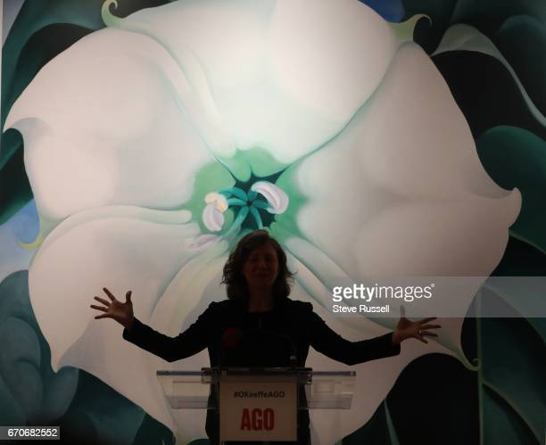 TORONTO ON APRIL 19 AGO curator Georgiana Uhlyarik stands in front of a reproduction of Georgia O'Keeffe's Jimson Weed/White Flower No 1 1932 as she...
