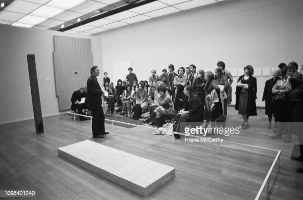 Curator giving a talk to visitors at the Tate Gallery, now known as the Tate Britain, London, UK, 6th April 1977.