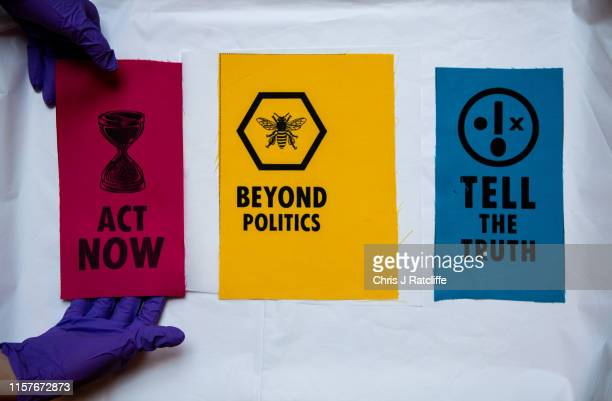 A curator handles cloth Extinction Rebellion patches at The VA on July 26 2019 in London England Today a series of new acquisitions exploring the...