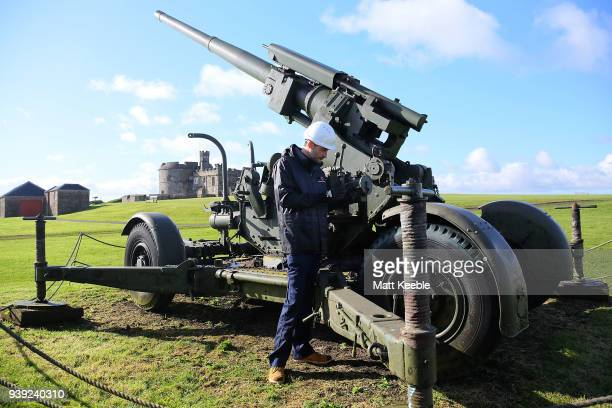 Curator Ian Leins inspects a Second World War antiaircraft gun at Pendennis Castle on March 28 2018 in Falmouth England English Heritage are warning...