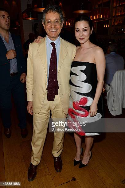 Curator Jeffrey Deitch and Actress China Chow attend the Aby Rosen Samantha Boardman Dinner at The Dutch on December 5 2013 in Miami Beach Florida