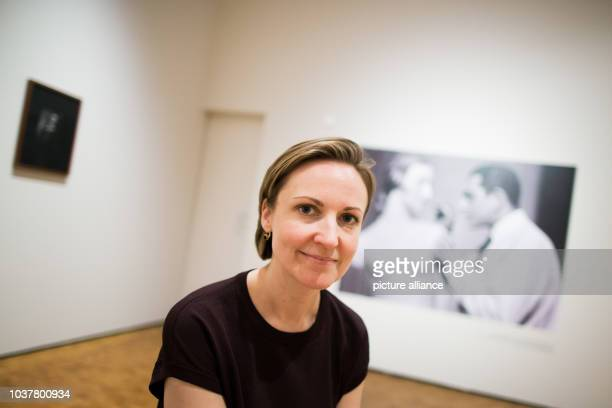 Curator Miriam Halwani sits in the exhibition 'Master of Beauty Karl Schenker_s Glamorous Images' in the Museum Ludwig in Cologne Germany 08...