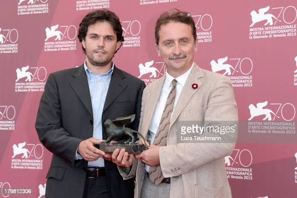 """Curator of Cineteca di Bologna Gianluca Farinelli poses with award during """"Venezia Classici"""" Jury Photocall during the 70th Venice International Film..."""