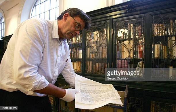 Curator of the State Library of NSW, Stephen Martin handles a carbon copy of the original Schindler's List following its discovery by The State...