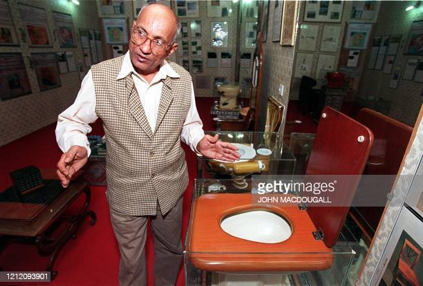 Curator of the Sulabh International Toilet Museum Mulk Raj gestures as he provides a guided tour of the museum's main exhibition hall 11 November...