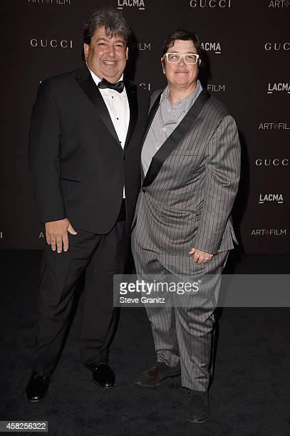 Curator Paul Schimmel and Cathy Opie attend the 2014 LACMA Art Film Gala honoring Barbara Kruger and Quentin Tarantino at LACMA on November 1 2014 in...