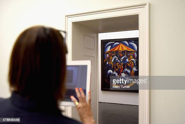 Curator Rachel Dickson takes a photograph of the newly installed Mark Gertler's MerryGoAround returns to Ben Uri on loan for the first time since its...