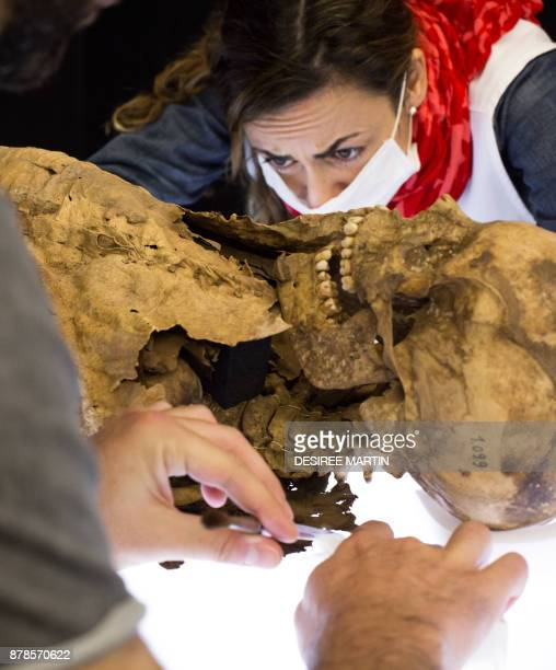 Curator Ruth Rufino Garcia prepares a female Guanche mummy of about 2530 years old and 155 metres tall found in the municipality of La Guancha to be...