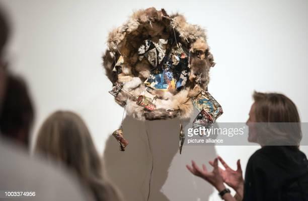 Curator Sabine Breitwieser explains the artwork 'Fur Wheel' at the exhibition 'Carolee Schneemann Kinetische Malerei' in Frankfurt/Main Germany 30...