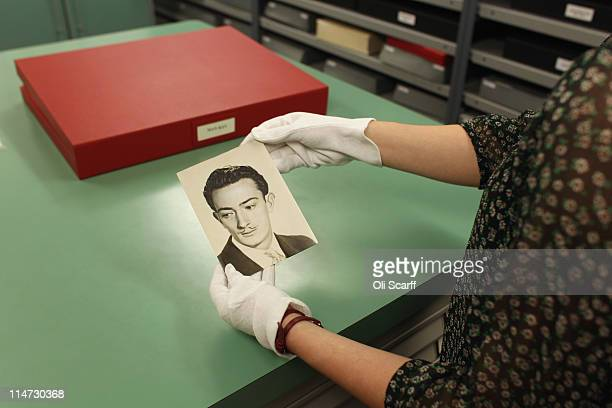 Curator Sarah McDonald holds a print of Salvador Dali by the photographer Man Ray in the Vintage Room of historic photographs in the Hulton Archive...