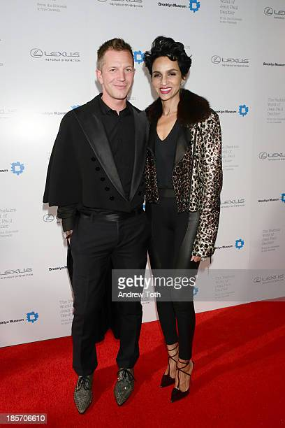Curator ThierryMaxime Loriot and Farida Khelfa attend the VIP reception and viewing for The Fashion World of Jean Paul Gaultier From the Sidewalk to...