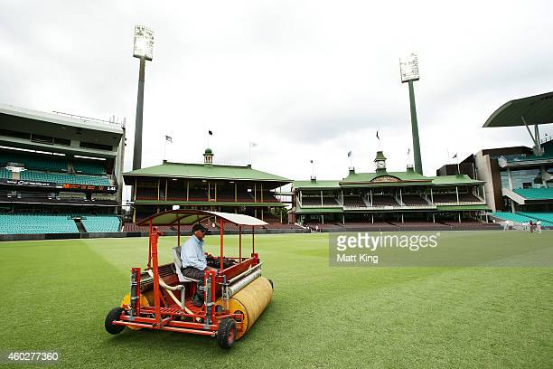 SCG curator Tom Parker works to prepare the ground after a rain delay during day three of the Sheffield Shield match between New South Wales and...