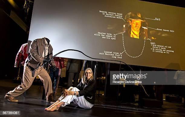 LOS ANGELES CA SEPTEMBER 17 2014 Curator/designer Deborah Nadoolman Landis posing with the Indiana Jones costumes in the the future site of the...