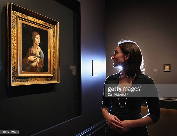 Curatorial assistant Francesca Sidhu poses besides a painting by Leonardo da Vinci entitled 'Portrait of Cecilia Gallerani' which forms part of the...