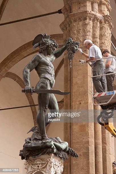 curators care for the statue of perseus - museum curator stock pictures, royalty-free photos & images