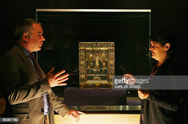 Curators Dr Adrian Locke and Professor Maria Vassilaki discuss a 12th Century enamel icon of the Archangel Michael at the Entrance to Paradise at the...