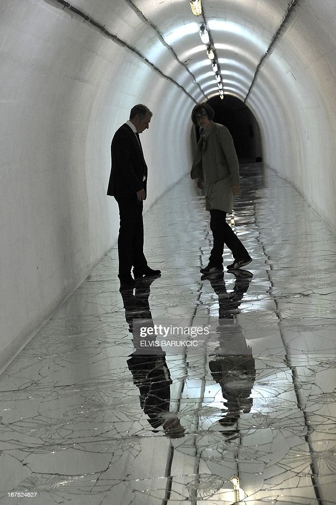 Curators of the 'D-0' art museum in Konjic near Sarajevo check on April 26, 2013 one of the installations in the corridors of the museum before the opening ceremony of Second Art Biennale. The art museum is placed inside of a former strategic nuclear shelter built by the Communist regime, 180 meters underground. Construction of the 'D-0' shelter was completed as the cold war era was coming to end and was never used by the military. It was maintained by the former Yugoslav Army until the war broke out in Bosnia in 1992. During the war, most of the equipment was preserved by the Bosnian Army until 2011, when the communist era relic was turned into an art museum.