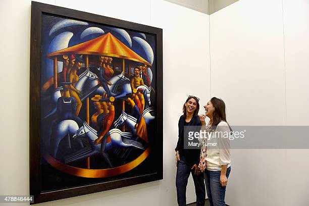 Curators Sarah MacDougall and Rachel Dickson look up at Mark Gertler's MerryGoAround as it returns to Ben Uri Gallery on loan for the first time...