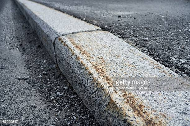 curb by road - curb stock pictures, royalty-free photos & images