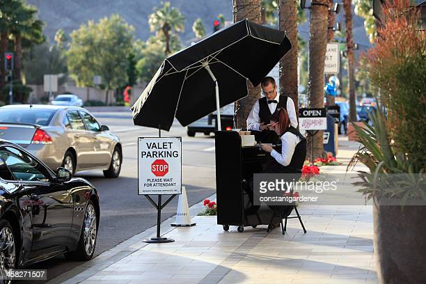 curb side valet parking - parking valet stock photos and pictures
