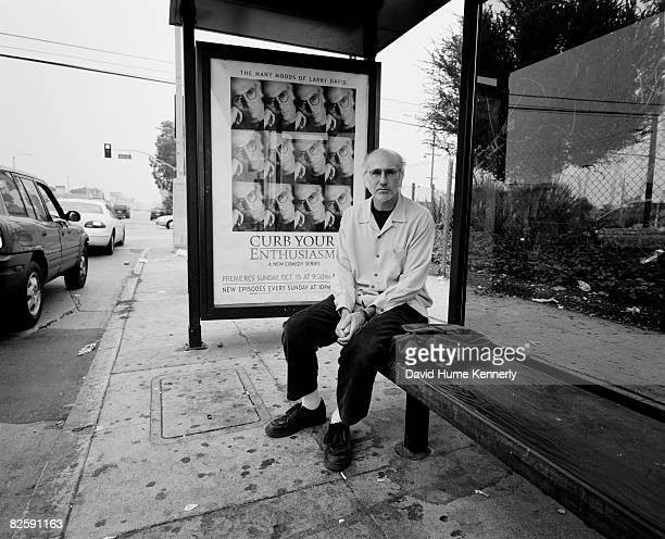 Curb Your Enthusiasm star and creator Larry David sits at the bus stop in front of his poster on October 20 2000 in Los Angeles California