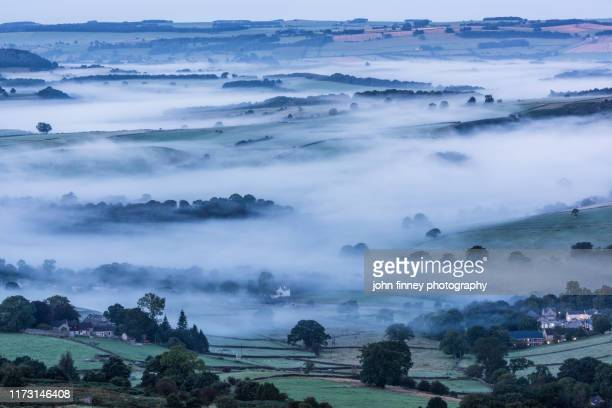 curbar dawn with mist and fog. derbyshire, peak district. uk - weather stock pictures, royalty-free photos & images