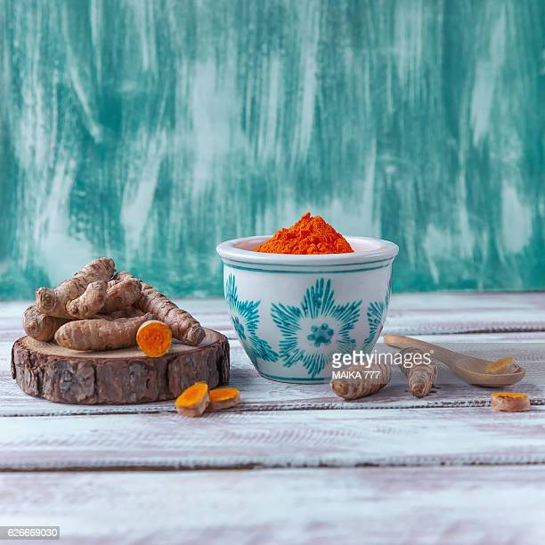 Curcuma roots (Curcuma longa) on wooden table