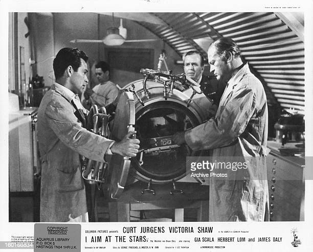 Curd Jürgens experiments in a lab in a scene from the film 'I Aim At The Stars' 1960