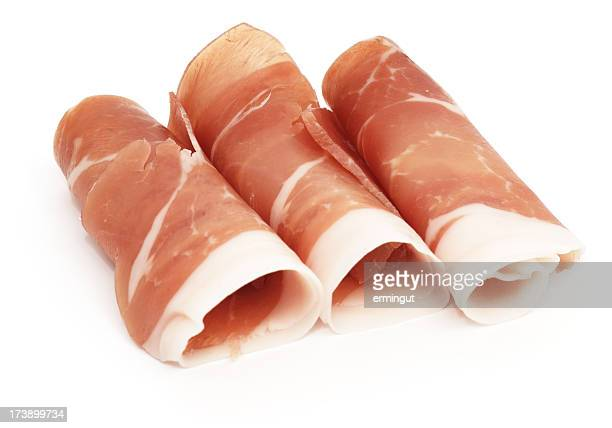 Cured Ham rolls - Prosciutto isolated on white