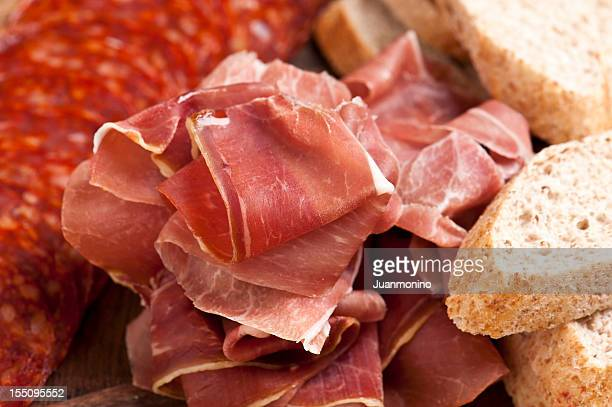 cured ham slices - serrano ham stock photos and pictures