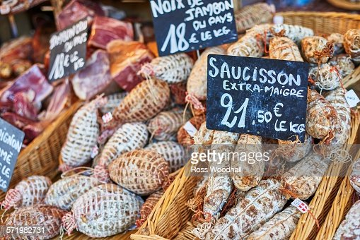 Cured sausages on French market stall, close-up
