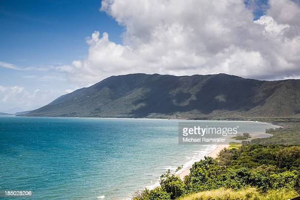 Curing Coastline of Blue Water, Jungle and Cliffs