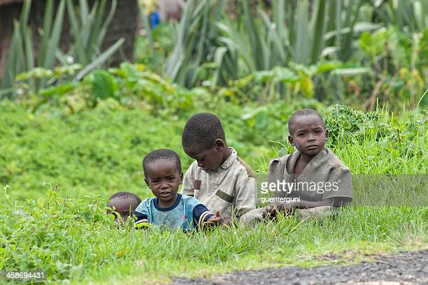 curios looking children at the roadside, north-kivu, congo - democratic republic of the congo stock photos and pictures