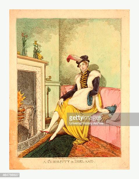A Curiosity In Ireland Lady Seated By The Fire London A Woman Sitting On Settee By Fireplace She Wears A Small Hat Trimmed With A Feather A Short...
