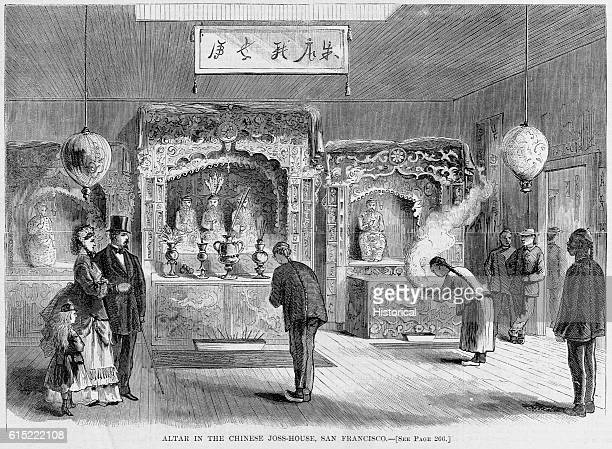 Curious American gentry watch Chinese men pray at an altar a JossHouse in the language of the time in San Francisco California 1871